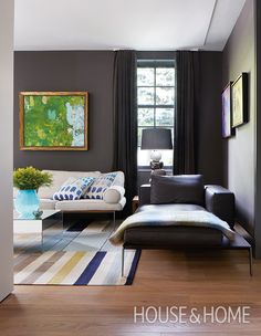 To create a warm, intimate living room, designer Connie Braemer swathed the walls in an unorthodox color: deep brown.   Photographer: Virginia Macdonald   Designer: Connie Braemer