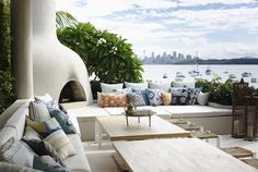 Like this great patio that takes advantage of the view and has an outdoor fireplace. Checkout the candle holders that are made of birdcages (I think). Design by Justine Hugh-Jones Outdoor Areas, Outdoor Rooms, Outdoor Living, Outdoor Furniture Sets, Outdoor Decor, Outdoor Seating, Wicker Furniture, Outdoor Sectional, Patio Interior