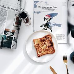Monday. French toast coffee and Sunday newspaper. by bonnietsang