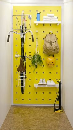 Transform a small closet with a trendy pegboard wall to store your bike and accessories.