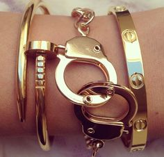 I would love that set of handcuffs bracelet and the Cartier Love bracelet one to the right of it.