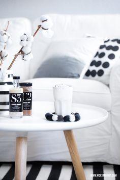 white nordic living room, felt ball coaster, cotton wool / normann copenhagen tablo, kähler omaggio, ikea stockholm, nicolas vahé