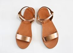 Minimal and chic ankle strap sandals with adjustable strap with buckle closure. By Savopoulos