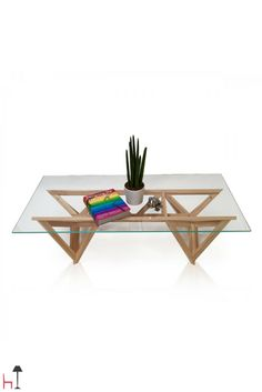 The Schegge low table by Valsecchi 1918 is made from solid ash wood with a glass top.