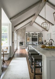 Open floor plan design with lofted ceilings and wooden beams | BRADSHAW DESIGNS