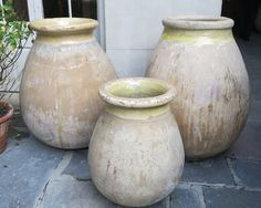 Classic for a French Quarter courtyard.  Antique French Olive Jars (via Antiques de Provence in New Orleans, LA)