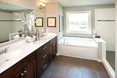Luxury vinyl tile is very practical in bathrooms, but is so versatile you could use it thorughout the home too.