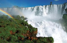 Comprised of a spectacular display of 250 giant cascades twice the height of Niagara Falls, Iguazu Falls plunges over hard granite to a gorge 260 feet below. Nature's incredible power is revealed in the thunderous roar of crashing water, and in the magic of the rainbow-colored mist that rises from the cliffs. This is your chance to see a Wonder of the World firsthand. You will ride the train to Devil's Throat and take a guided walk covering approximately one mile to view the falls.