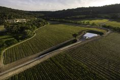 Renzo Piano Building Workshop designed an art pavilion in Le Puy Ste Réparade, France, carving a 6 meters deep valley in the earth so as to fully incorporate the building into the vineyard.