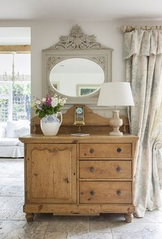 Love the wood tone mixed with the subtle taupes and greys, such a pretty dresser in farmhouse style