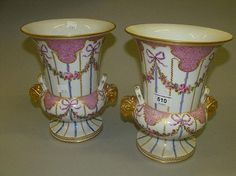 Pair of late Sevres porcelain two handled urn