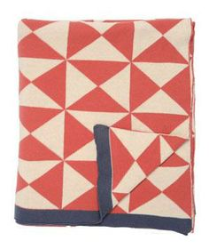 Coral Wind Farm Patterned Throw: Add color and dimension to a bedspread or sofa with this geometric 100 percent cotton knitted blanket.