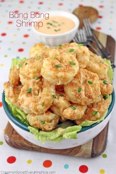 Bonefish Grill's Crunchy Bang Bang Shrimp _ A copycat restaurant recipe for Bang Bang Shrimp. Breaded shrimp fried up all golden and crunchy then smothered in a spicy sauce & served over greens. It's all the rage!