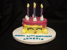Cartoon birthday cake with fondant candles and accents
