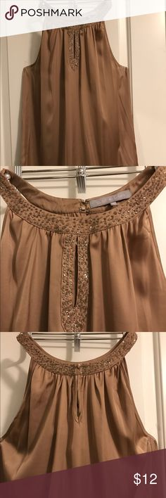 Beautiful bronze gold beaded neckline top Gorgeous bronze gold beaded neckline top. Dress it up with jeans and my Venus strappy heels (see listing). 100% polyester. Violet & Claire Tops