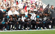 Jacksonville Jaguars players kneel during the U.S. national anthem before  the game. Football Players 717be0245