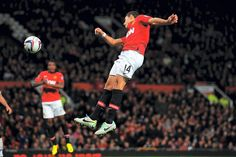 Javier Hernandez leaps to score his second.