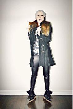 black military coat with black wedge sneakers
