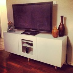 Ikea TV stand with a mid century legs..