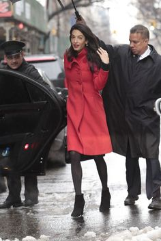 Amal Clooney outside the Carlyle Hotel in New York City in a Paule KA coat. See all her best looks.