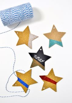 Turn plain cork and chalkboard tags into pretty decorations for gifts or place cards using Mod Podge and glitter! From MichaelsMakers Mod Podge Rocks