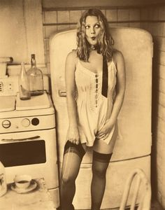 Drew Barrymore wearing vintage undies and nylons...with a run in them apparently..lol