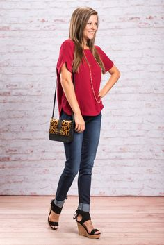 This cute wine top is exactly where we want to be! It looks great with a dark pair of jeans or even some white skinnies! We also love the exposed half zipper in the back. This simple top is so well made and so chic you are going to find so many things to wear this beauty to!  Material has no amount of stretch.  Miranda is wearing the small.  Sizes fit: Small- 0-4; Medium- 6; Large- 8