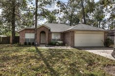 Behind HEB 6819 Woodland Oaks, Magnolia, CONTENDER $184,995 and 1,696 ft and Built 1999 $280 HOA Trees, covered patio, easy bath