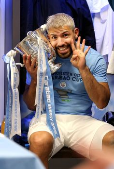 Sergio Aguero of Manchester City celebrates victory with the trophy in the dressign room after the Carabao Cup Final between Chelsea and Manchester City at Wembley Stadium on February 2019 in. Get premium, high resolution news photos at Getty Images Football Icon, Football Boys, Soccer Guys, Soccer Players, Manchester City Wallpaper, Sergio Aguero, Kun Aguero, Big Six, English Premier League