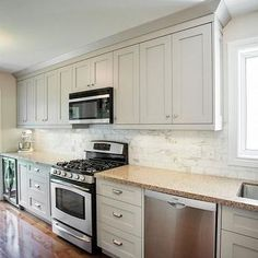 i actually really love these cabinets  the color is modern White Kitchen Cabinets with Black Hardware Blingy Hardware for Kitchen Cabinets White