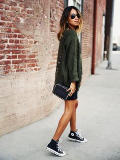 street style, casual, converse, black sneakers, Sincerely Jules. Layer a colored sweater over your LBD and pair it with a feminine bag and sneakers for a look that combines ladylike and tomboy style.