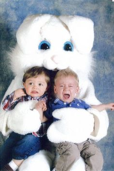 """Look, no matter which way you cut it, a 6-ft bunny is creepy. I love the captions the blogger put under these pics. For this one: """"Poor things.  They're scared to death.  And, in their defense, the Easter Bunny does look like he is literally gnawing on their heads."""""""