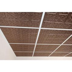 To cover the basement suspended ceiling tiles. Ceilume - Fleur-de-lis Faux Bronze Ceiling Tile, 2 Feet x 2 Feet Lay-in or Glue up - V3-FLEUR-22BBR - Home Depot Canada