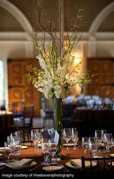 tall centerpiece design with curly willow branches, dendrobium orchids and hydrangea