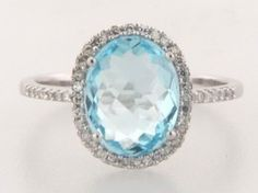 WOW! Ive been using this new weight loss product sponsored by Pinterest! It worked for me and I didnt even change my diet! I lost like 26 pounds,Check out the image to see the website, anniversary/push present - blue topaz and diamond halo ring