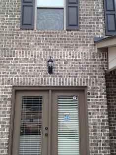 Everest Gray Tudor brick with Ivory mortar.using Gray mortar instead. Grey Stone House, Grey Brick, Brick And Stone, Dream House Exterior, Exterior House Colors, Exterior Design, Brown Brick Houses, Outside House Colors, Painted Brick Exteriors