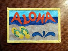 PDF Pattern to make this Hawaiian themed mug rug, made with these Hawaiian appliques.  You can use them for setting your mug on with a snack, or my favorite way, leaning them against the wall in my hutch. You can even stitch rings to the back and hang on your wall.  These are the funnest of things to make! If you choose the machine applique, you can whip these up in no time. They make great gifts when given with a cute mug. They are so easy whether you hand applique or machine applique. The…