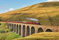 Steam train crossing the Ribblehead Viaduct, North Yorkshire Settle to Carlisle Railway England.