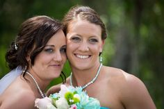 Shayla wearing a Swarovski white pearl necklace with crystal rhinestone rondelles, and matching earrings, on her wedding day. Shanna, her matron of honor, wearing a similar necklace and earrings, but with Tiffany blue (turquoise) pearls.
