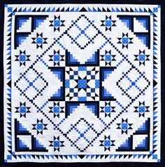 Blue-and-white raffle quilt by Kitsap Quilters - 2016