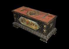Florentine carved and painted wooden chest. 17th-18th c. Italian.  Painted scene of a medieval city on the front panel, fabric-covered lid with strap hinges, central carved heraldic insignia.  113 x 45 x 47.5 cm