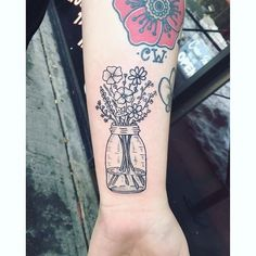 Pin for Later: 21 Seasonal Tattoo Ideas For Anyone Who Really, Truly Loves Spring A Mason Jar of Flowers