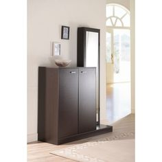 @Overstock.com - Macey Multi-functional Shoe Storage Cabinet - Keep all of your favorite shoes organized and within reach with this modern shoe storage cabinet. Getting ready for the day will be easy with the full-length mirror and storage shelves, while the walnut finish will complement your existing decor.  http://www.overstock.com/Home-Garden/Macey-Multi-functional-Shoe-Storage-Cabinet/7180445/product.html?CID=214117 $289.79