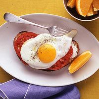 Eggs Goat cheese and tomato toast.
