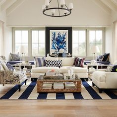 Coastal living room full of fun patterns with a blue and white color palette