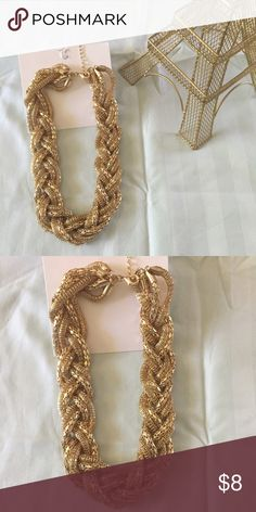 New H&M gold necklace Brand new H&M gold toned necklace with an intertwined style (: H&M Jewelry Necklaces