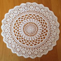 This doily is edged with flowers!  Ravelry: Angel's Garden Doily pattern by Chinami Horiba