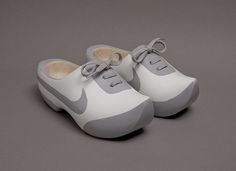 Johnny Kelly painted wooden clogs to look like a pair Nikes for the Nike78 exhibition--hmmm  you could paint clogs too