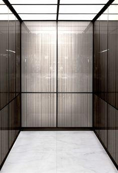 A sleek, contemporary solution to elevator cab finishes. Stair Elevator, Elevator Design, Elevator Lobby, Lift Design, Cabin Design, Lobby Interior, Luxury Interior, Marble Stairs, Wood Cladding