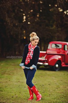 red rain boots and plaid scarf